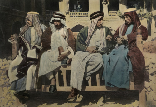 mediterraneum:  Men socialize at their club, the outdoor coffee house, Iraq.