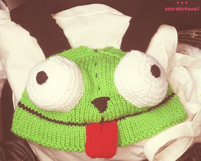 Oops! Forgot to post this in March.  The pattern is Invader Zim GIR Knit Hat by Yarngear (Mei Lynne Travis). I think I've had the pattern in my Ravelry queue for years. I don't remember adding it so when I stumbled on it when updating my queue last week, I had to make it for my sister. It has a knit in hem which is really awesome. You basically knit your brim 2x as long as you want it to be, fold it, and knit the stitch and the corresponding cast on loop together. I used Red Heart Super Savers and US#8/5mm needles for everything since I don't really have needles in other sizes. I also crocheted the eyes instead of knitting them.