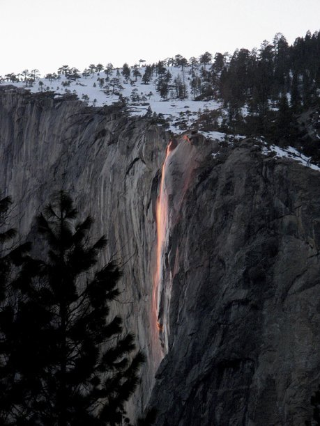 "Horsetail Fall flows over the eastern edge of El Capitan in Yosemite Valley. It's a small waterfall that many people don't notice, but it has gained popularity as more and more people have noticed it can glow orange during sunset in mid to late February.The most popular place to see Horsetail Fall seemingly afire is El Capitan picnic area, west of Yosemite Lodge and east of El Capitan (see map below). The ""firefall"" effect generally happens during the second half of February. A clear sky is necessary for the waterfall to glow orange.Photo: Bethany Gediman, NPS"