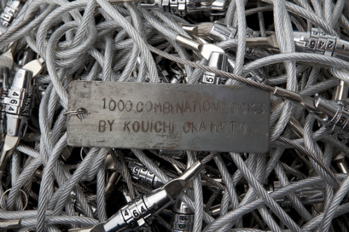 """1000 combination locks"" is a wire ball puzzle game which uses 1000, 3 dial key combination locks"