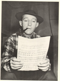nprfreshair:  Kevin Whitehead on Bing Crosby's influence on popular music:  Bing Crosby's influence on modern singing is so huge, we barely notice it anymore. It spread out through deadpan crooners like Perry Como, folksy colloquialists like Johnny Mercer, and warm sexy baritones like Billy Eckstine. Later singers who effectively undersell a song are indebted too, like Nick Drake and Leonard Cohen.  Image of Bing Crosby reading the sheet music is from a CBS radio recording session in the fall of 1954, at the CBS studio in Hollywood courtesy of HLC Properties Ltd.