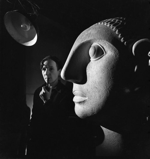 "Emile Savitry, Anton Prinner in his studio, next to his sculpture ""Woman with big ears"", Paris, 1946"
