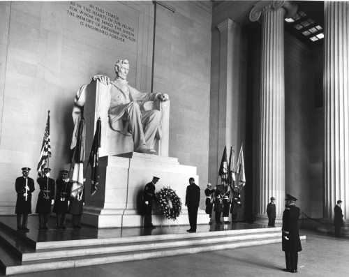 "February 12, 1967. Lincoln's Birthday. LBJ lays a wreath at the Lincoln Memorial and says a few words:  ""So Lincoln began his troubled journey towards a new concept which would go beyond theories of black power or white power; beyond the ancient blinders of racism to the establishment of a multi-racial community in which a man's pride in his racial origins would be wholly consistent with his commitment to the common endeavor.  ""He died before he had the opportunity to give voice to this vision.  ""We can never know what course history would have taken had Booth's bullet not brought down this towering political saint and stoked the fires of vengeance.  ""We do know that it has taken more than a century for us as a nation to assert the ideal that Lincoln had barely formulated.  ""It has required the hard lessons of a hundred years to make us realize, as he realized, that emancipating the Negro was an act of liberation for the whites.""  President Johnson, Remarks at a Ceremony at the Lincoln Memorial. February 12, 1967. LBJ Presidential Library photos 9896-O, 9896-J by Abbie Rowe of the National Park Service. Public domain."