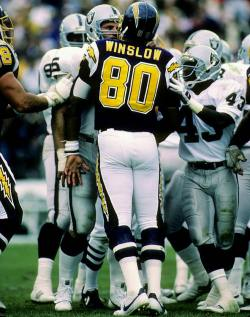 Kellen Winslow and Howie Long exchange words during a 1985 Chargers-Raiders game. San Diego would go onto win the game 40-34 in overtime. (George Rose/Getty Images) GALLERY: Rare Photos of the 1985 NFL Season