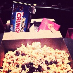 Watching #startrek. This is how I do #popcorn. With some #nestle bunch a crunch. If you don't know now you know baby baby. #snacks #movies #junkfood #candy  (at AMC Southcenter 16)