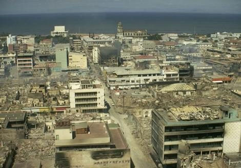 whatthezeitgeistwants:  El Centro de Managua—the ruins of the old downtown destroyed in the 1972 earthquake, never rebuilt due to corruption and political turmoil, still extant as a naturally occurring post-apocalyptic zone. I was there during the Sandinista years, and the images of people cooking over oil drum fires in abandoned buildings, Sherman tanks tagged with graffiti and overgrown with prairie grasses, and experimental Kindergartens underway in excavated basements, left an indelible impression.
