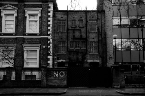 No! I love the mood in this picture. A typical cloudy day in London.