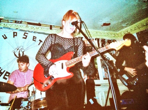 "GOOD GRRRL BANDS - BLEACHEDI love me some punk & roll. I like it even better when it's played by (mostly) ladies, and I can't think of a band doing a cooler, poutier job of catchy, sunkissed melody-led guitar music right now than LA's Bleached. They write music to soundtrack driving down Sunset in your vintage convertible eating fruit flavoured ice pops and dribbling the juice down your chin whilst singing along to The Ramones on the cassette player. Ergo, they rule. I have been super lucky to catch them live twice (both shows were EXTREME FUN), and I was even luckier to talk to Jessie from the band about Suzi Quatro, why female music fans rule and a ton of other cool stuff thrown in for good measure.   1) Firstly, could you sum up Bleached and the kind of music you guys play? Well….. Bleached started with Jen and I after our first band broke up. We're still all buddies! That band was Mika Miko that we started in highschool so we were really young having fun, but after a while everyone was getting older going different directions, but Jen and I knew we were still wanting to play music together so we started Bleached! We started with more of a garage sound and slowly after three 7 inches and now a full length we have more of a rock'n'roll pop sound with influences of punk and garage.    2) Tell me about your forthcoming LP - should we expect a continuation of your output so far or is it going to blow everyone away and be like an entire album of Destiny's Child covers? (NB: I would totally buy the DC record)   I think its definitely in between a continuation and Destiny's Child covers!     3) Something that I think is really cool about Bleached is that you're obviously influenced by male ~PUNK LEGENDS~ like the Ramones and Misfits but you also manage to merge those influences with a sound that has a kind of feminine edge. Do you make a conscious effort to do so? How important are musical influences to Bleached?  Having a musical influence is really important to us while writing a song. It helps you have a direction and also Jen and I can communicate….. When one of us has a certain band or song we're thinking of, its helps to then both be on the same page with the song. I don't really consciously think about the combination with a feminine edge, I think the feminine edge just comes from our other influences of female punk bands or female singers like The Slits, Blondie, Siouxsie etc.   4) Did you guys grow up going to shows in your local area? What were your initial experiences of your local music scene(s) like? I think that a really big problem with these small scenes where shows are attended by a lot of the same people is that it can become super clique-y, and often, because most of the time these things are so male dominated, women can feel alienated. Is that something you have experienced, either when attending shows or playing them?  Our first shows were places like Cobalt Cafe or American Legion Hall in the San Fernando Valley that were smaller venues, but our venues started expanding through seeing flyers for shows in orange county so we would go out there….. We were kind of addicted to shows. I was still in high school and that's why I feel like I went to so many shows, because it didn't feel clique-y like high school did. When I was younger playing our first shows, I totally remember feeling slightly intimidated by some ""dudes"" but I feel like some of it was how you present your self…. Now that I am older and feel way more confident I really don't feel alienated or any kind of wall between sexes. Not to say that it never happens, I just don't let it happen.    5) Do you have any girl heroes or women you look up to (in music, or like in life generally)?  I don't usually say this a lot because I didn't really grow up listening to her music… but Suzi Quatro is someone that grows on me more and more everytime I look up youtube videos of her playing. She was totally her own unique lady having all male backing band and was before Joan Jett who I'm pretty sure was majorly influenced by her, but Suzi just looks so cool and rock'n'roll!   6) Do you think that people (journalists/fans/whoever) would respond differently to Bleached if you weren't a predominantly female group/do you feel you get treated the same as or differently than bands at the same kind of level as you professionally but that are all dudes (like do you ever find that people make more comments about how you look and what you're wearing than about your sound and if your set was good?)? How do you deal with this and is it annoying or tough?  I never really find myself getting annoyed at certain comments, there's always going to be that one person that will have some kind of annoying comment, but you have to let that go in one ear and out the other because it can really tear you down if you don't. If I let someone who I have never met upset me with a comment I feel like I would subconsciously start to change who I am and the music I write and then I would just be so lost and insecure.    7) Is it flattering to have so many female fans? Do you feel like you're role-models for your younger fans? I read that you've played at Rookie events and stuff like that - it must feel great to be doing something which (other) young women dig so much, right?  The other night we were playing the Burgerrama fest and this girl came on stage and kissed us on the cheeks…. I was so stoked! Then I saw her run into the crowd and crowdsurf and then I was even more stoked! I love female fans because I am one too and they're part of the reason why I started playing music so if any girl were to pick up an instrument because of seeing us play that would make me so happy!    8) Is there any Yoda-like advice you'd give to girls and women who wanna make music?   I would have to say just to be confident about yourself and know that it takes hard, dedicated work to learn an instrument. My dad use to always tell me to play till your fingers bleed!    9) Which bands should my readers and I be listening to right now?   Veronica Falls, Meat Market, Pangea…..    10) One of the next zines I'm gonna do will be about women in TV shows, so my final question IS: who is Bleached's favourite female TV character? Alex Mack      Bleached's debut full length Ride Your Heart is out now and it rocks so hard. Please go listen to it. LAUREN OUT XOXOXOphoto credit: me!"