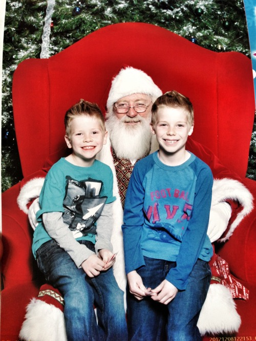The boys and Santa!   After some shopping for clothes and Christmas at the mall, we decided to make a pit stop and see Santa!!  The boys were quick to tell Santa exactly what they wanted, which involved BB guns, iPads, iPods, Nerf guns, helicopters, and the normal stuff each and every boy would want, right?   Looking at this picture brings the awareness of my boys are getting older.  It seems like yesterday they were learning their very first steps, learning to eat on their own, and their first potty experience, riding a bike for the first time, first days of preschool, and all of those wonderful memories stuck in the back of my memory.  It brings such an appreciation and gratification in being their Dad.  I am a very blessed Father two have such loving boys as my own.  They are growing so fast and all I want is for it to stop so I can savor up every moment of it.   I absolutely love their smiles in this photo with Santa!