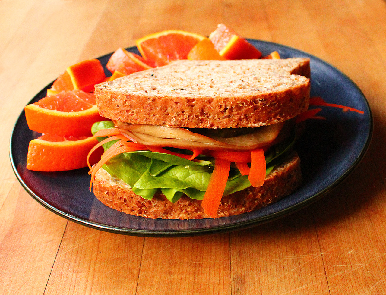 Hickory smoked tofurky sandwich on sprouted whole grain bread with ...