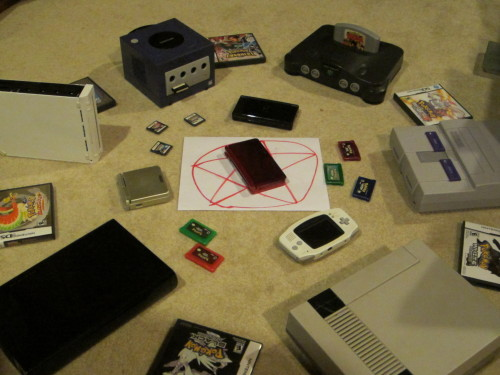 kokiri-saria:  I'm attempting to summon Pokemon X and Y for the 3DS early  Satan doesn't deem your lack of Yellow, Red, Blue, Original Gameboy, Gameboy Color, Mew movie Promo card, and fake blood  pentagram worthy of the game. All you summon is a shiny invisible Bulbasaur that turns into a Bad Egg in your PC.