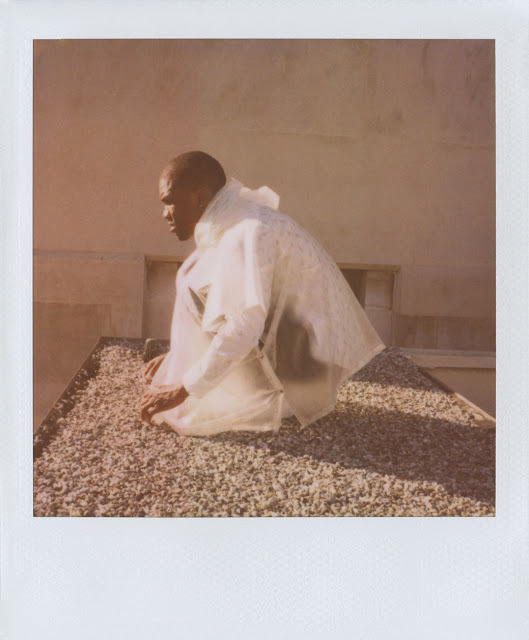 "Frank Ocean Goes Polaroid for Band of Outsiders This story was published in partnership with The Daily Beast.  Frank Ocean has officially gone high fashion. He's the face of Band of Outsiders's Spring/ Summer 2013 campaign, which was released in a series of Polaroids on Wednesday. In the photographs, which were shot by the brand's designer, Scott Sternberg, Ocean wears several looks from the collection.   In one picture, Ocean reclines in a tuxedo on a park bench in Downtown Los Angeles; in another he lies listlessly on a grass lawn — in a third, he sits in a poncho on a cement stoop. And Ocean looks good in the clothes: afterall, he wore a yellow Band of Outsiders suit onstage during his performance at the Grammys last month. Ocean joins a long line of stars that have appeared in campaigns for the brand. The painter Ed Ruscha rode a motorcycle in a campaign last year – and Michelle Williams, Kirsten Dunst, Andrew Garfield and Amy Adams have all made cameos in Sternberg's now-famous Polaroid campaigns in the past. The Fall 2012 campaign featured Josh Brolin as a modern cowboy. At the time, Sternberg told us that there would only be two more Polaroid campaigns, and that afterwards he would publish a book of them. ""It's time to close the chapter on the Polaroids,"" he told us. ""It's time to evolve.""  — Isabel Wilkinson"