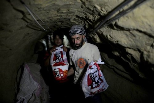 evamelnikova:  Guys from KFC Egypt deliver food to their Palestine brothers, going in this underground tunnel  Source: NY Times