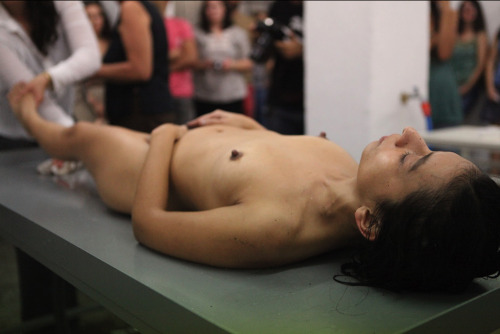 7knotwind:  Alud (Landslip)Performance, 2011 (video here)Regina José Galindo the artist's words:Water runs. The body is there, dirty. The public's position as observer is replaced by the action of participating and cleansing the body. Motivated, perhaps by some empathy for the unknown individual, hidden behind the mud.