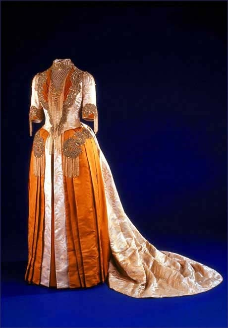 tawnyscostumesandcuriosities:  Mary Harrison McKee's Inaugural Gown,1889. Mary McKee wore this elaborate Victorian gown to her father's inaugural ball in 1889. In accordance with President Benjamin Harrison's economic philosophy of supporting home-based manufacturing, the gown was intentionally all-American. Indiana artist Mary Williamson designed the fabric pattern, and the Logan Silk Co. of Auburn, NY, wove the brocaded fabric. The fabric of the gown incorporates a pattern of goldenrod, President Harrison's favorite flower.