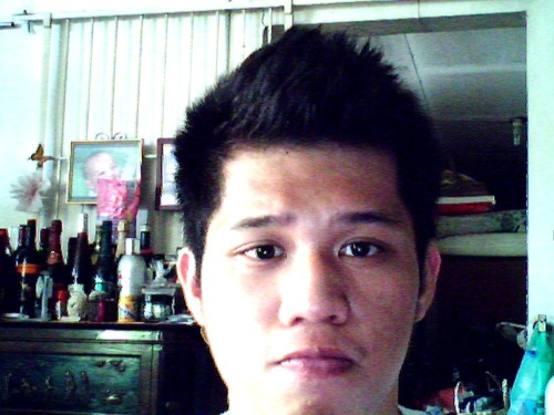 fugly pic… but to have a haircut or not… planning to get a hair cut days before the concert but GAH… :)))))))) mukha nakong ewan :))
