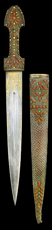 ledecorquejadore:    A CORAL AND TURQUOISE INLAID OTTOMAN DAGGER, TURKEY, 18TH CENTURY The polished steel blade of straight form with central groove and incised lines either side, damascened with makers name and date 1128AH/1715AD, the hilt of typical form set with coral and turquoise stones, the scabbard with fish-scale design to centre and reverse, similarly set with coral and turquoise and terminating in a dragon head - 21in (via Pinterest)    Source: pinterest.com