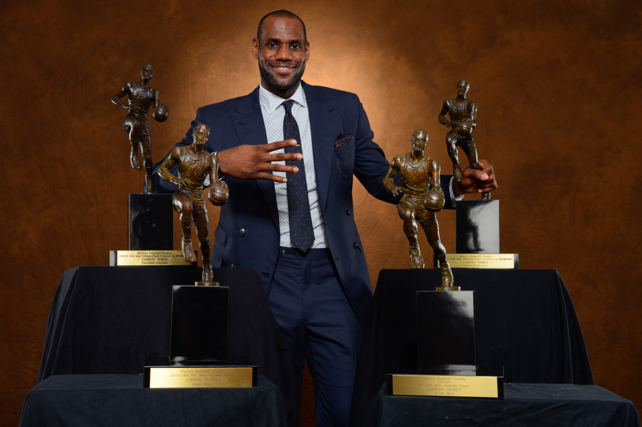 nba:  LeBron James of the Miami Heat poses with his collection of Maurice Podoloff Trophies after being named the 2012-2013 Kia NBA Most Valuable Player (MVP) of the Year for the fourth time on May 5, 2013 at American Airlines Arena in Miami, Florida. (Photo by Jesse D. Garrabrant/NBAE via Getty Images)