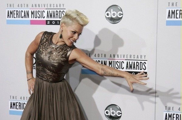 "P!nk Sued By Ex-Producers For $36, 213.31, They Claim She Has Not Paid Her Past Royalties Singer P!nk whose real name is Alecia Beth Moore was sued by her former producers who claim she has cheated them off $36, 213.31 in royalties, TMZ reported. The suit was filed in New York City, December 2012 by Specialists Entertainment claiming that the ""Most Girls"" singer had signed a deal with them and with Thunderstone Productions for the production of her debut album in 1999. ""According to the suit, the two companies agreed to split producers' royalties 50-50 … before cranking out 2 songs, ""'Can't Take Me Home' and 'Hiccup' for P!nk,"" TMZ reported. Read more at MStars"