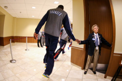 nba:  Kevin Durant of the Oklahoma City Thunder greets an usher on his way to the court to play the Memphis Grizzlies in Game Five of the Western Conference Semifinals during the 2013 NBA Playoffs on May 15, 2013 at the Chesapeake Energy Arena in Oklahoma City, Oklahoma. (Photo by Layne Murdoch/NBAE via Getty Images)
