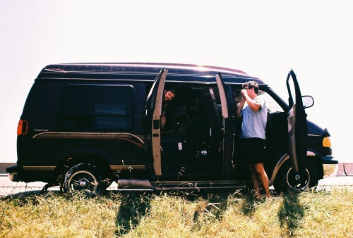 out-of-light:  Tim and Tanner and a flat tire.