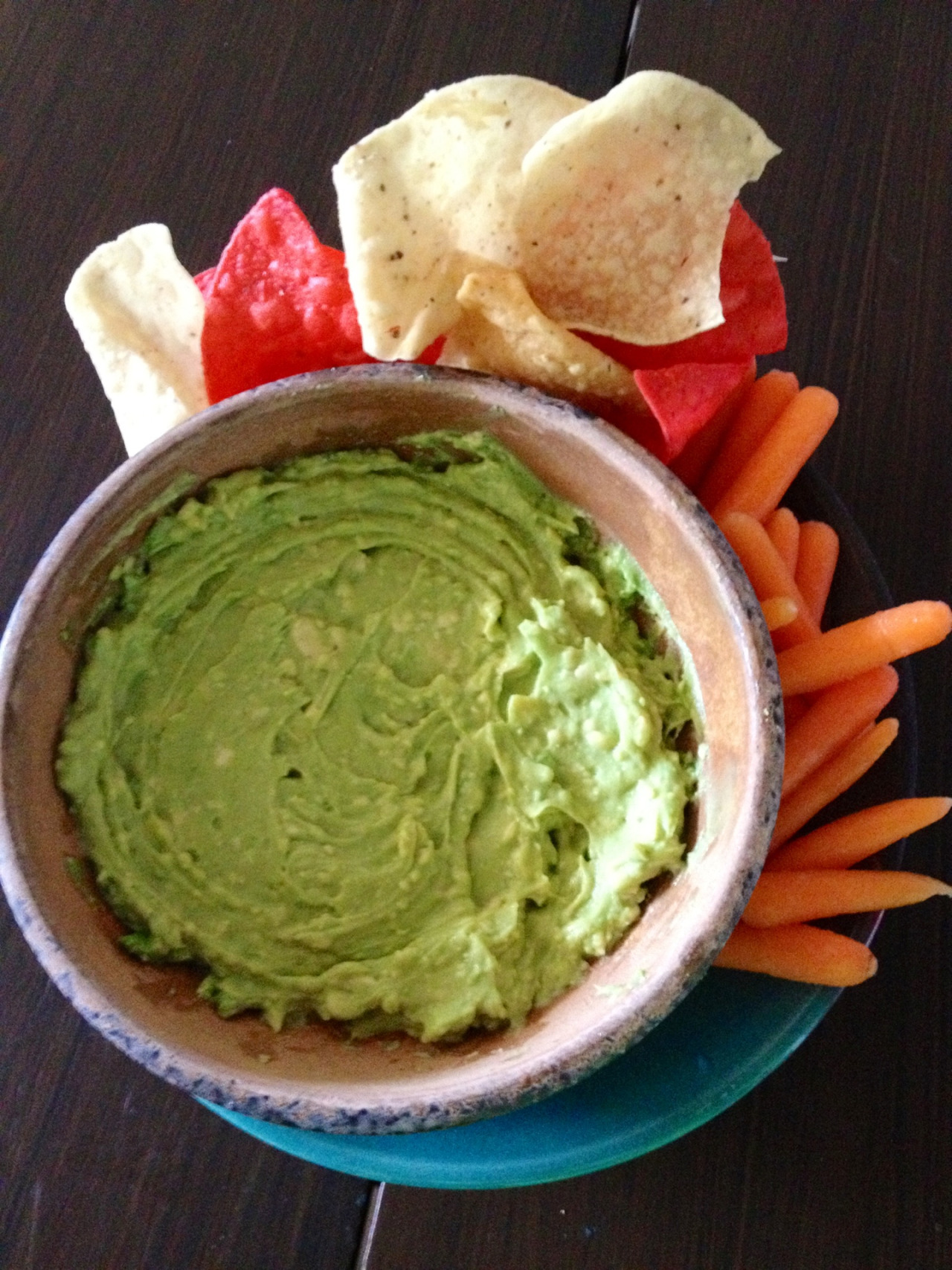 thecluelessvegan:   I made some homemade guacamole for Alli and I as a snack! We will nom with baby carrots and corn chips. Ole!