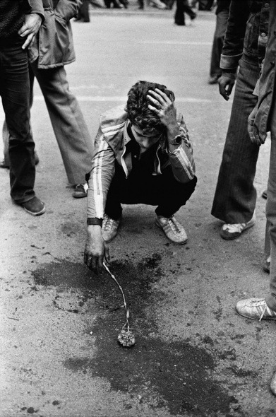 Flower and blood, Tehran, January 26, 1979 A student mourns a friend shot outside of Tehran University (Picture by Kaveh Golestan)