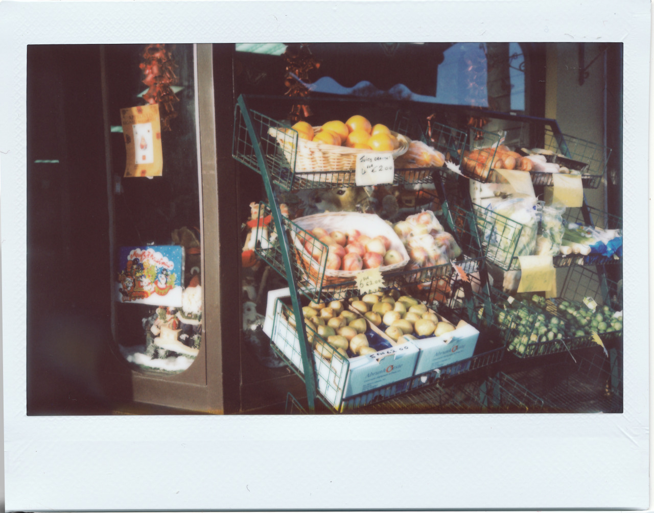 So I got a Fuji Instant 210 for Christmas or my birthday not sure which and I can honestly say I have not been as excited about photography for a wee while.  This is my 4th exposure of  fruit stall in the village I live.