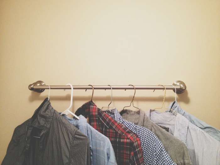 Brian's shirts neatly hanging.