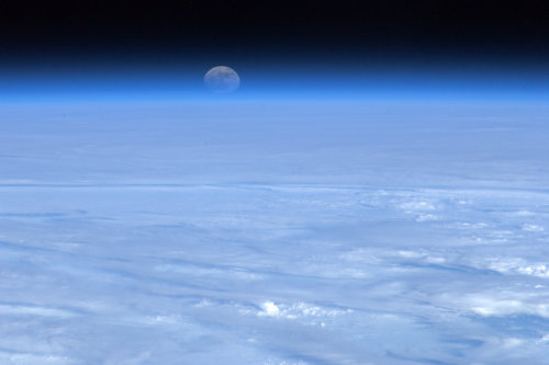 colchrishadfield:  The Moon rising over a bed of cloud. A constant reminder to us all of what can be achieved.