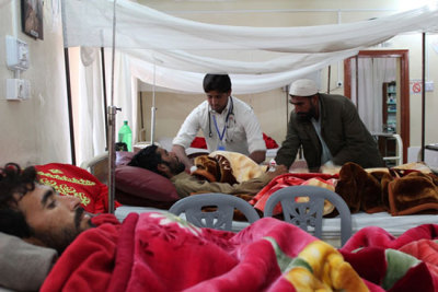 "Photo: MSF medical staff examines patient in surgical ward in Hangu Tehsil Headquarters (THQ) Hospital. MSF supports the Hangu THQ Hospital by running emergency room and providing surgical care. Pakistan 2012 © Haroon Khan/MSF Pakistan: More than 110 Treated for Blast Wounds Ahead of Elections Pakistan is experiencing an increase in violence related to the general and provincial elections taking place on May 11, in the country's first democratic transition of power. MSF staff treated patients for blast injuries at facilities in Hangu and Lower Dir, Khyber Pakhtunkhwa, and Kurram Agency in the Federally Administered Tribal Areas. ""The escalation in violence has caused massive devastation over a short period of time,"" said Jean Guy Vataux, MSF country representative in Pakistan. ""This is exacerbating an already very difficult situation for the Pakistani people who continue to bear the brunt of these violent acts on every level."" Noncombatants have been the primary victims of the recent violence, which follows several months of armed conflict in Pakistan that mainly injured members of the security forces and armed militants, according to Pakistani media reports."
