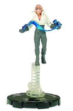 This Heroclix figurine is from the Justice League set, which debuted in 2007.  As you can see, he stands on a transparent platform like the Trickster II Heroclix. Kadabra is considered a Rare figure, but isn't difficult to find online.