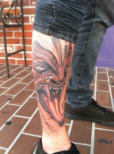 a demon tattoo i did on a friend tattoo artist that works with me at INKAHOLIK TATTOOS. design by tommy lee