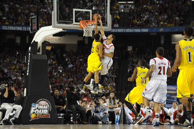 Trey Burke blocks Peyton Siva late in the second half of Monday's National Championship Game. The play was called a foul by the refs and the Cardinals seized momentum, holding off the Wolverines for a 82-76 victory. (David E. Klutho/SI)