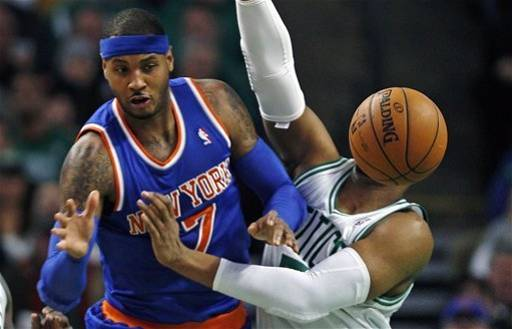 The Celtics just couldn't stop Carmelo Anthony tonight, not even when they tried Mr. Met's basketball-headed cousin, Señor Baloncesto, as a defensive stopper.  Señor Baloncesto committed two fouls in three scoreless minutes, though he did have some impressive no-look passes. (AP Photo/Charles Krupa)