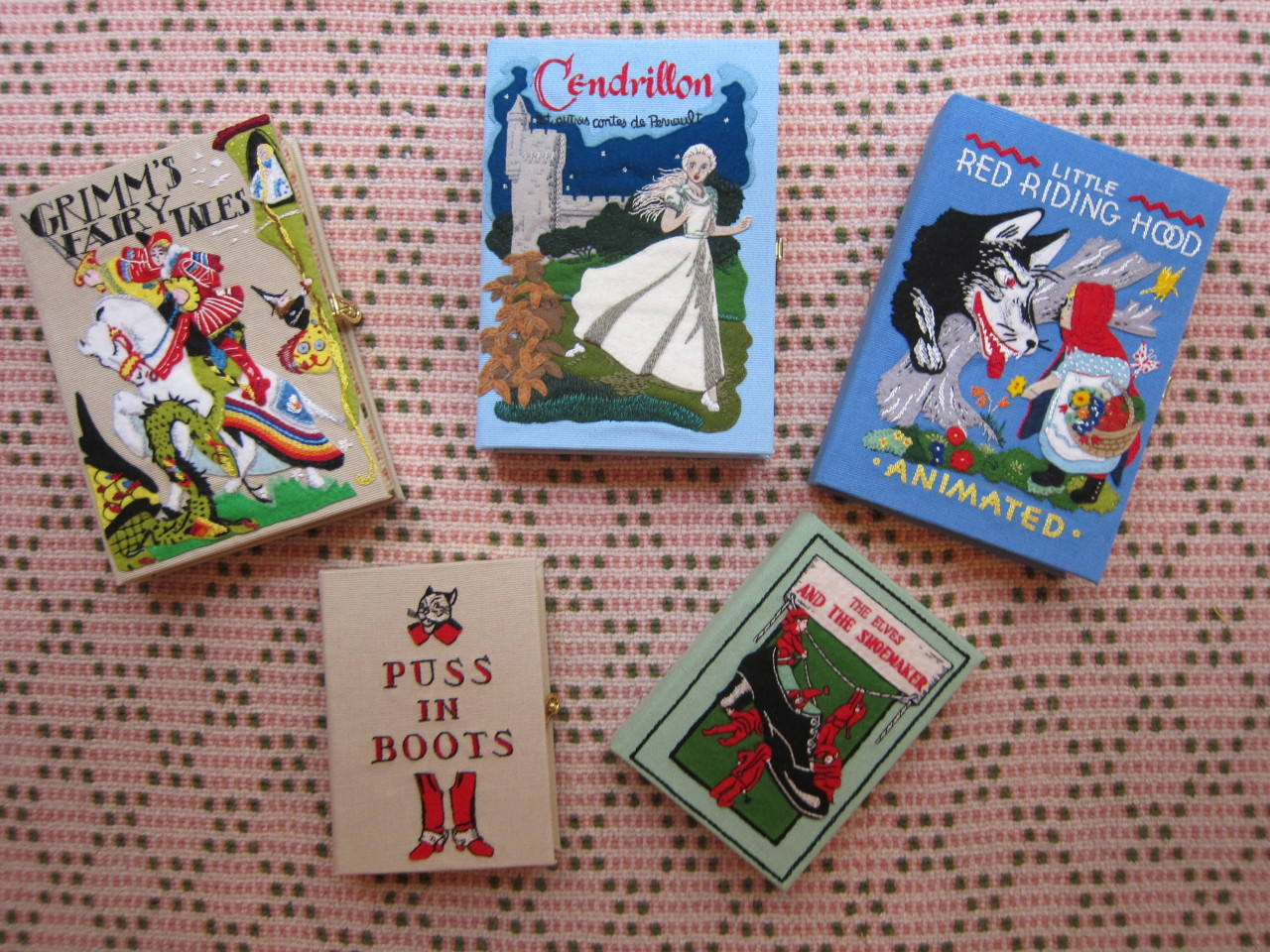Fairy tale book-clutches by Olympia Le-Tan for Charlotte Olympia.