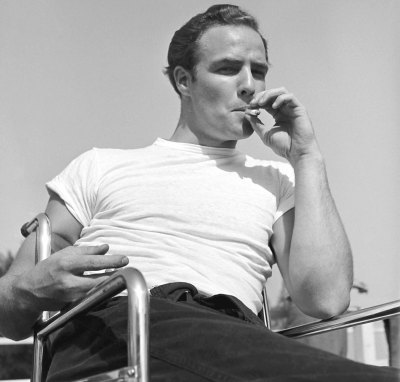 life:  Happy birthday, Marlon Brando — celebrate with rare photos from the early days of his career. Not originally published in LIFE. Marlon Brando takes a break while training for his role in The Men, 1949. (Ed Clark—Time & Life Pictures/Getty Images)