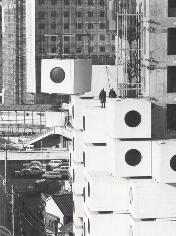 Tokyo's Nakagin Capsule Tower being assembled in 1972. The 14-story high building has 140 capsules stacked at angles around a central core. In accord with the principles of exchangeability, expansibility and flexibility put forward by the Metabolist movement, architect Kisho Kurokawa developed the technology to install the preassembled capsule units into the concrete core with only 4 high-tension bolts, making them easily detachable and replaceable when needed. Kurokawa's idea was that every 25 years or so, the units could be replaced, giving the building a 200 year life span. In reality however, none of the capsules were ever replaced and the lack of maintenance over the last three decades has taken its toll on the building. Until his death in 2007, Kurokawa fought to keep the structure and update the capsules as he originally planned. Today the tower remains under constant threat of demolition.