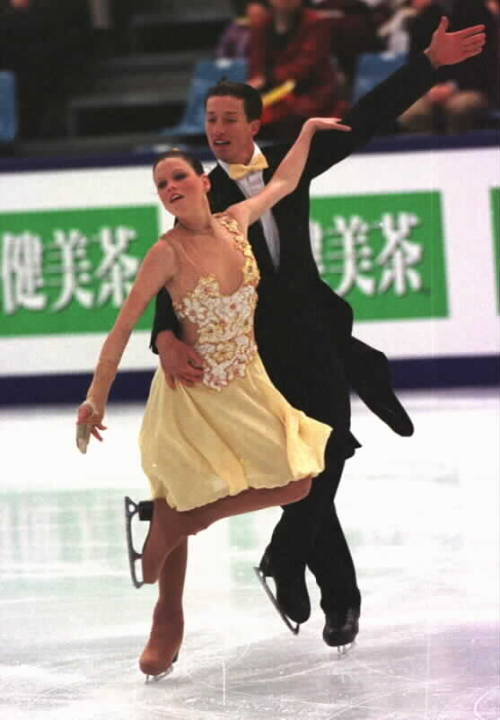 Natalie Buck and Trent Nelson-Bond skating the Golden Waltz at the 2002 World Championships. Photo by Barry Mittan.