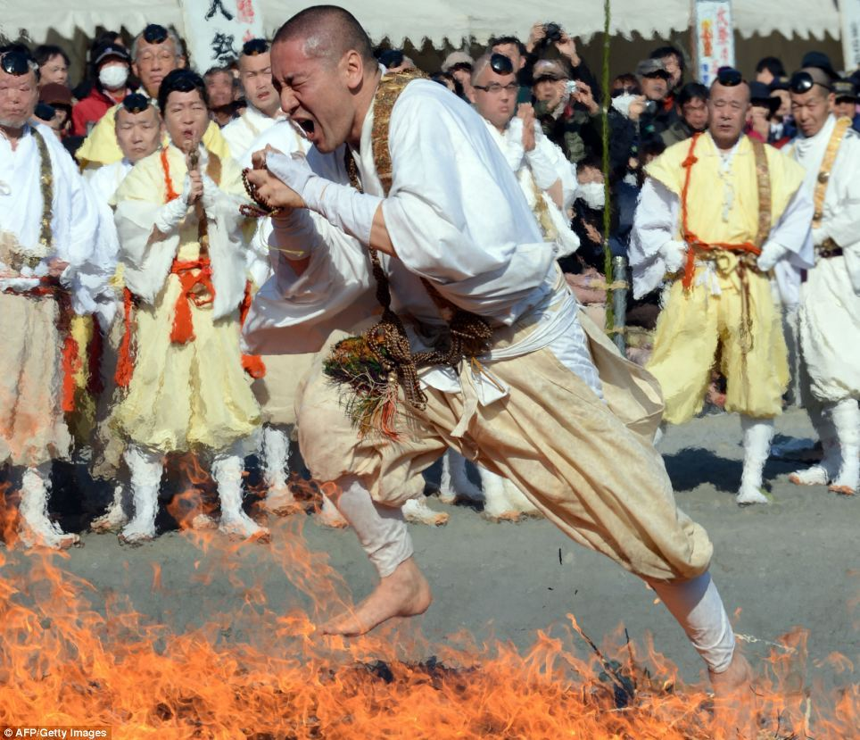 Buddhist monks dash through flames barefoot to celebrate the arrival of spring | Mail Online