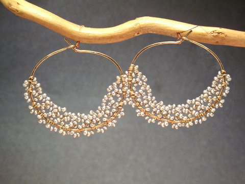 (via Cleopatra 118 Hoops wrapped with tiny seed by CalicoJunoJewelry)
