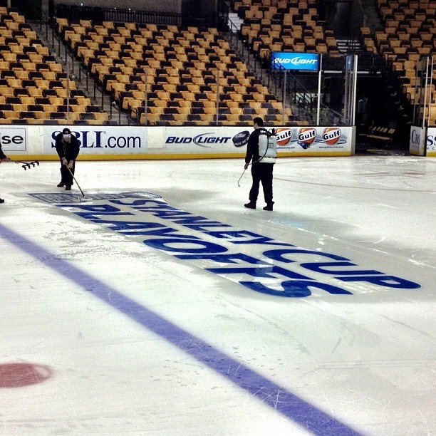 nhlbruins:  2013 Stanley Cup Playoffs logo getting placed on the TD Garden ice #nhlbruins