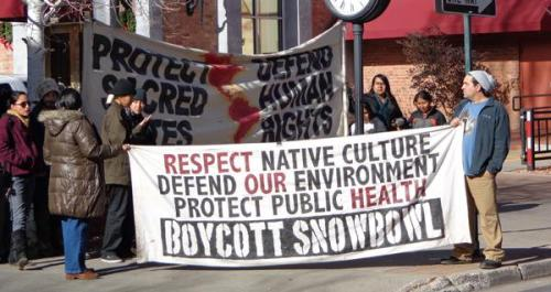 Arizona Snowbowl Protestors Charged in Federal District Court Three activists were charged in federal District Court in Flagstaff, Arizona, today with disrupting work in a U.S. Forest Service office, following a protest they staged there over snowmaking with treated effluent on the sacred San Francisco Peaks.