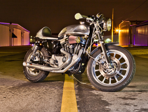 Posted a HD Cafe Racer that was submitted and asked if anyone knew anything about it. BAM….Brian submits a couple of links and I found a few more pics of the bike. Cheers Brian.