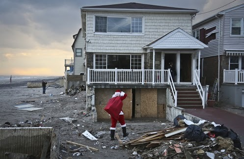 'Sandy Claus' delivers toys to storm-stricken kids (Photo: Bebeto Matthews / AP) The Associated Press reports — From his toy-cluttered Brooklyn apartment, the man in the red suit was making his list and checking it twice. But he made no distinction between naughty or nice: Every child on it would receive a gift from this Santa Claus. Read the complete story.