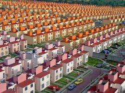 "plasm0:  rationalityoftheruled:  Housing development, Mexico.  ""A few years ago when I was working as a helicopter pilot for a local radio station, we were required to fly around all of Mexico City chasing news and traffic. I remember flying up to the highway that connects Mexico City with the neighboring state of Puebla, and on my way back this housing complex that seemed to go on forever caught my attention. I decided to circle around to observe from up close what I later found out was the recently built San Buenaventura complex, which is located in Ixtapaluca, on the eastern outskirts of Mexico City. The exceptional afternoon sun reflecting those thousands of recently painted small homes just looked so beautiful, and the lower I flew the better the angle, so I just got out my camera, opened the sliding window on my Bell helicopter, and snapped a couple of shots."" —Oscar Ruiz This seems like a reasonable post for my 2000th. This complex is MENTAL.   Fuck"