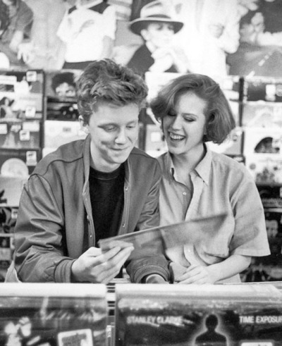 Anthony Michael Hall and Molly Ringwald: record shopping during their break  in the location shooting of 'The Breakfast Club;, May 1, 1984.