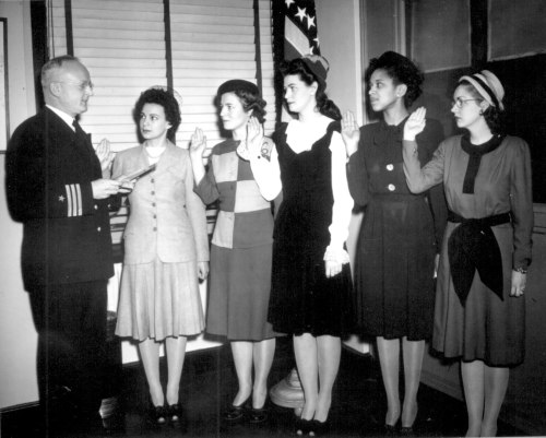 "Cmdr. Thomas A. Gaylord, USN (Ret'd), administers oath to five new Navy nurses commissioned in New York…"" Phyllis Mae Dailey, the Navy's first African-American nurse, is second from the right. March 8, 1945.  (via National Archive)"