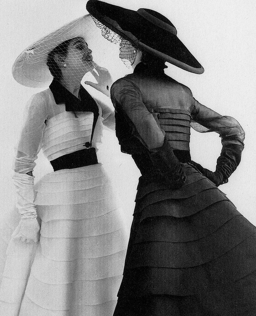 theniftyfifties:  Model wearing fashion by Jacques Fath, 1952. Photo by Norman Parkinson.