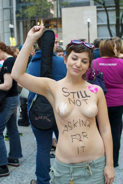 "This photo of Ashley from the Chicago Slutwalk 2012 protest was posted on STFU, Conservatives Tumblr page last night. While it's not a bad pic of her, the comment exchange that followed was pretty awesome.One person wrote, ""…its kind like putting a meat suit on and telling a shark not to eat you"".STFU responded:""We (men) are not fucking sharks! We are not rabid animals living off of pure instinct. We are capable of rational thinking and understanding. Just because someone is cooking food doesn't mean you're entitled to eat it. Just because a banker is counting money doesn't mean you're being given free money.Just because a person is naked doesn't mean you're entitled to fuck them. You are not entitled to someone else's body just because it's exposed. What is so fucking difficult about this concept?""Bravo."
